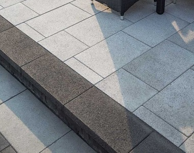 new raven grey granite pool coping drop face tiles and pavers, grey coping, dark coping tiles by stone pavers melbourne sydney brisbane canberra adelaide