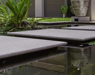 raven granite pool coping bullnose tiles, grey coping tiles, dark coping tiles, black granite pool coping by stone pavers australia, pool steppers