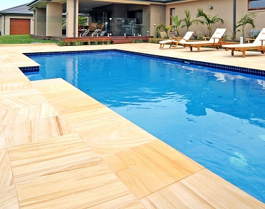 teakwood sandstone pavers and tiles, yellow tiles, ochre tiles, pool pavers and pool coping melbourne, sydney, brisbane, canberra adelaide,