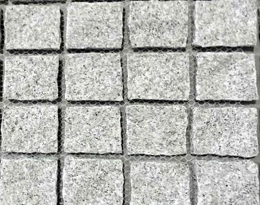 Dove White natural split cobblestone tiles and pavers