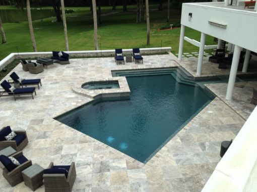 oyster silver travertine tiles around swimming pool by stone pavers melbourne