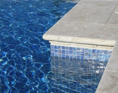Ivory Travertine Bullnose Pool coping tiles, cream pool coping tiles, round edge pool coping tiles by stone pavers