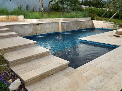 ivory travertine pool coping tumbled tiles, cream stepping coping, biege tiles by stone pavers melbourne and sydney