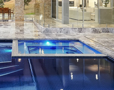 silver travertine pool coping tumbled tiles, silver tiles, silver coping, silver pavers by stone pavers melbourne