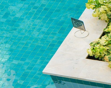 white pool coping tiles, drop face pool coping pavers, stone pavers melbourne, sydney